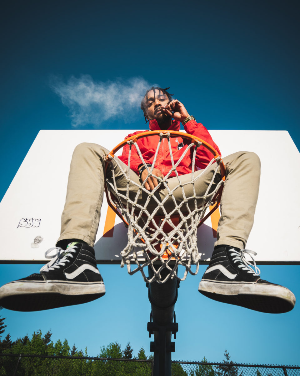Man smoking on basketball stand